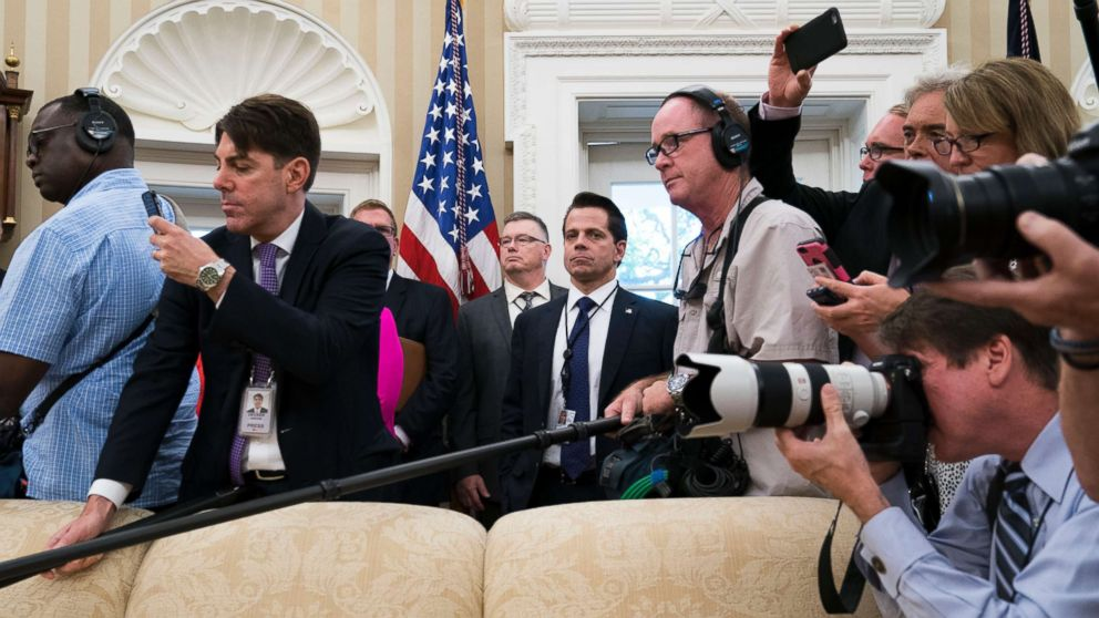Outgoing White House Communications Director Anthony Scaramucci, surrounded by reporters, is pictured while President Donald Trump meets with John Kelly, his new Chief of Staff, in the Oval office of the White House, July 31, 2017.