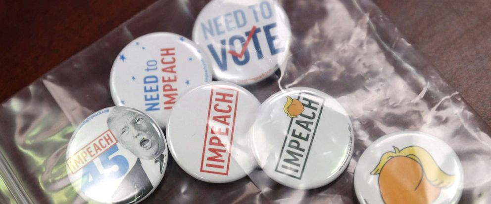 PHOTO:Buttons are set out for attendees at a Need to Impeach teach-in at a public library in Chantilly, Va., June 22, 2019.