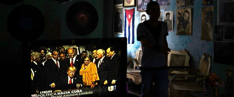 PHOTO: A television set shows President Donald Trump signing the new Cuba policy in a living room festooned with images of Cuban leaders at a house in Havana, Cuba, June 16, 2017.
