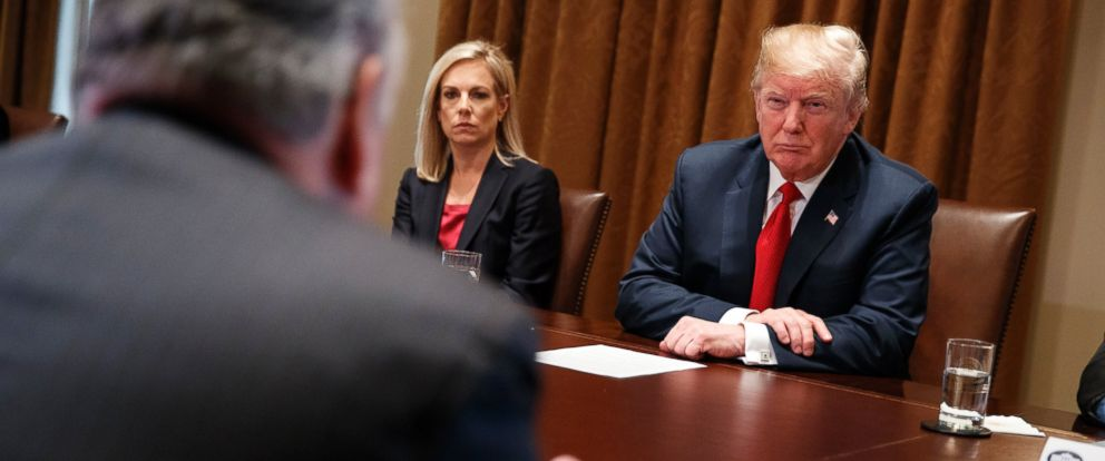 Secretary of Homeland Security Kirstjen Nielsen and President Donald Trump listen to Rep. Peter King, R-N.Y., during a meeting with law enforcement officials on the MS-13 street gang and border security, in the Cabinet Room of the White House.
