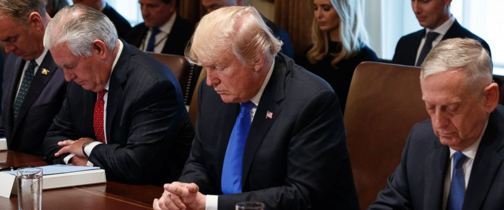 President Donald Trump prays during a cabinet meeting at the White House, Wednesday, Dec. 20, 2017, in Washington. From left, Secretary of Interior Ryan Zinke, Secretary of State Rex Tillerson, Trump, and Secretary of Defense Jim Mattis.