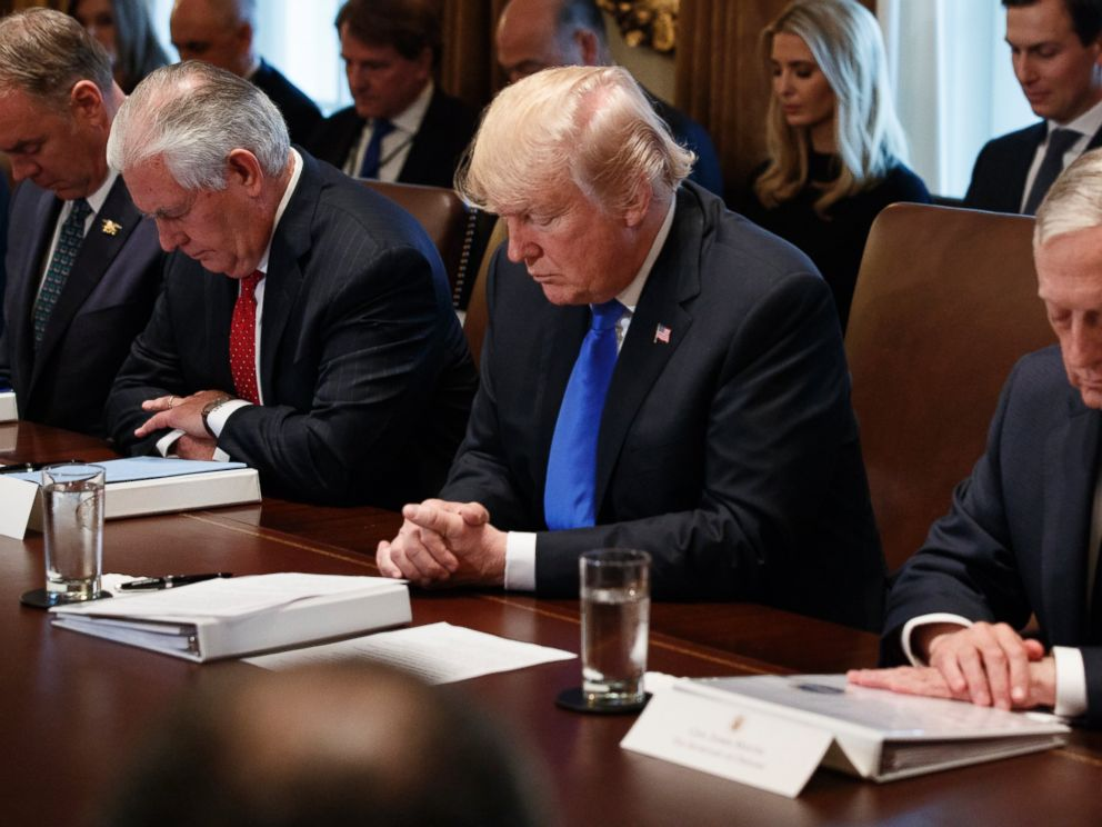 President Donald Trump prays during a cabinet meeting at the White House Wednesday Dec. 20 2017 in Washington. From left Secretary of Interior Ryan Zinke Secretary of State Rex Tillerson Trump and Secretary of Defense Jim Mattis