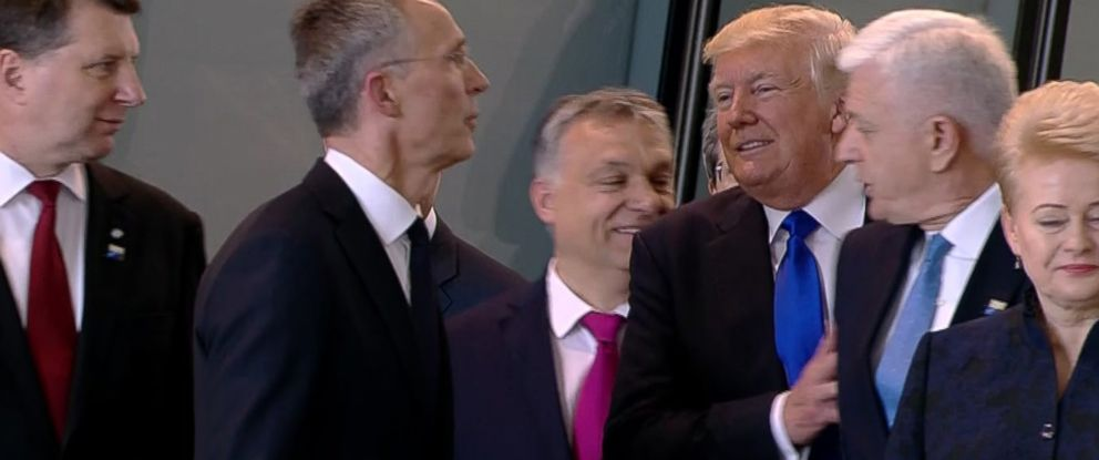 PHOTO: Montenegro Prime Minister Dusko Markovic appears to be pushed by President Donald Trump as they were given a tour of NATOs new headquarters during a NATO summit of heads of state and government in Brussels on May 25, 2017.