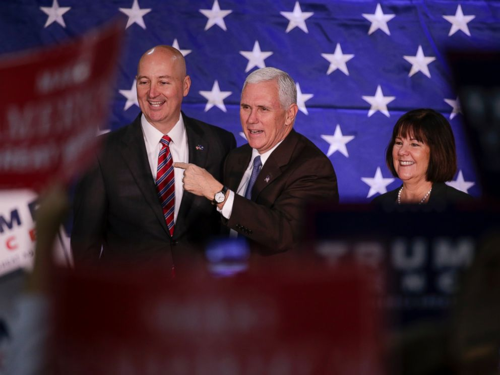 PHOTO: Mike Pence, and his wife Karen, stand on stage with Nebraska Governor Pete Ricketts before speaking at a campaign stop in Omaha, Oct. 27, 2016.
