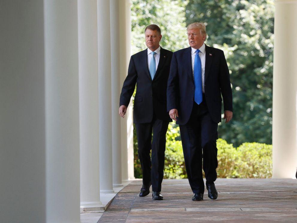 PHOTO: President Donald Trump and Romanian President Klaus Werner Iohannis walk to the Rose Garden for their joint news conference at the White House, June 9, 2017.