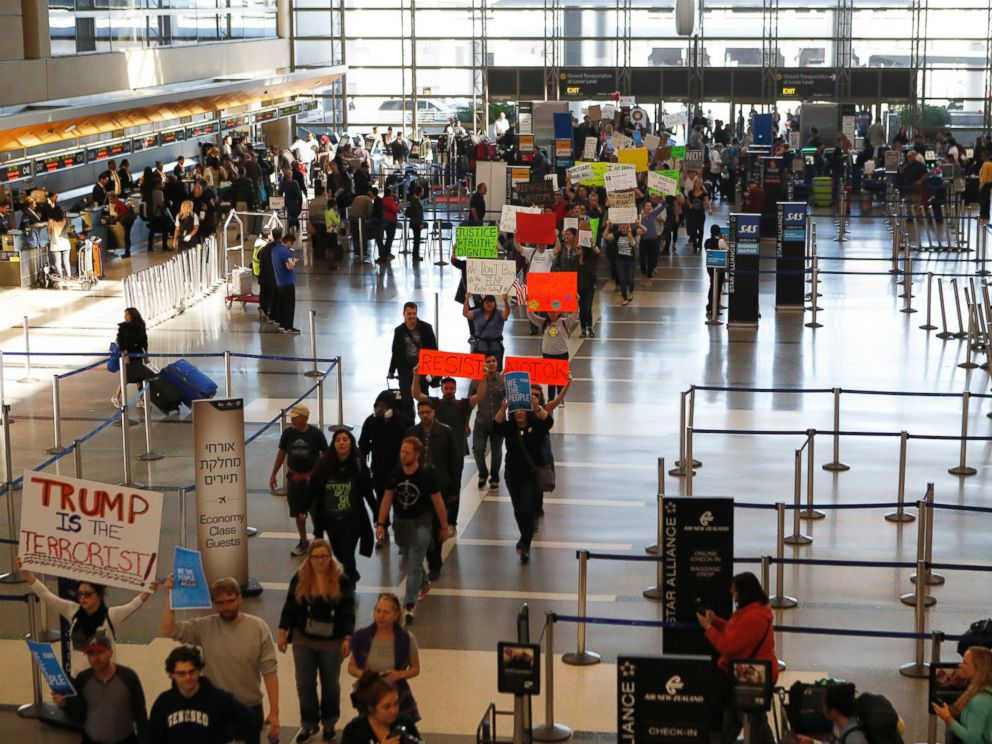 PHOTO: Demonstrators march through Tom Bradley International Terminal as protests against President Donald Trumps executive order banning travel from seven Muslim-majority countries continue at Los Angeles International Airport, Jan. 29, 2017.