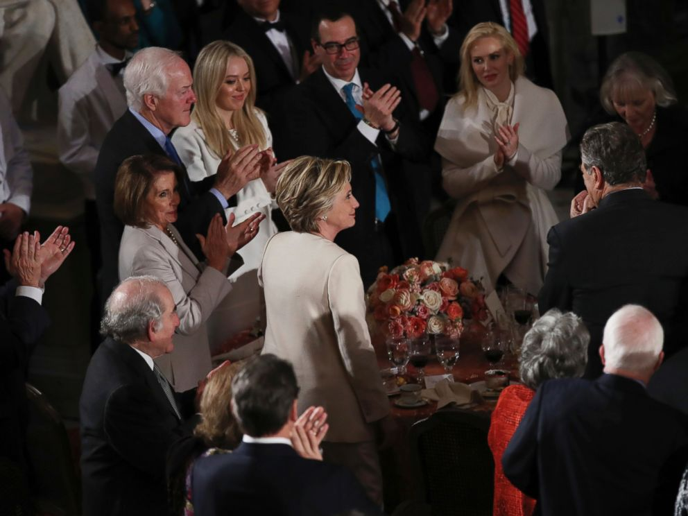 PHOTO: Hillary Clinton stands as she is recognized by President Donald Trump during his speech at the inaugural luncheon at the Statuary Hall in the Capitol, Jan. 20, 2017, in Washington.