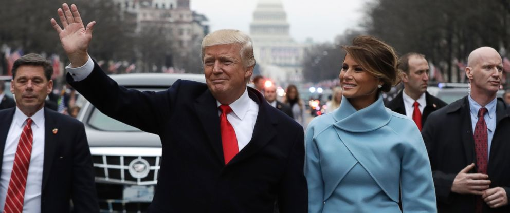 PHOTO: President Donald Trump waves as he walks with First Lady Melania Trump during the inauguration parade on Pennsylvania Avenue in Washington, Jan. 20, 2017.