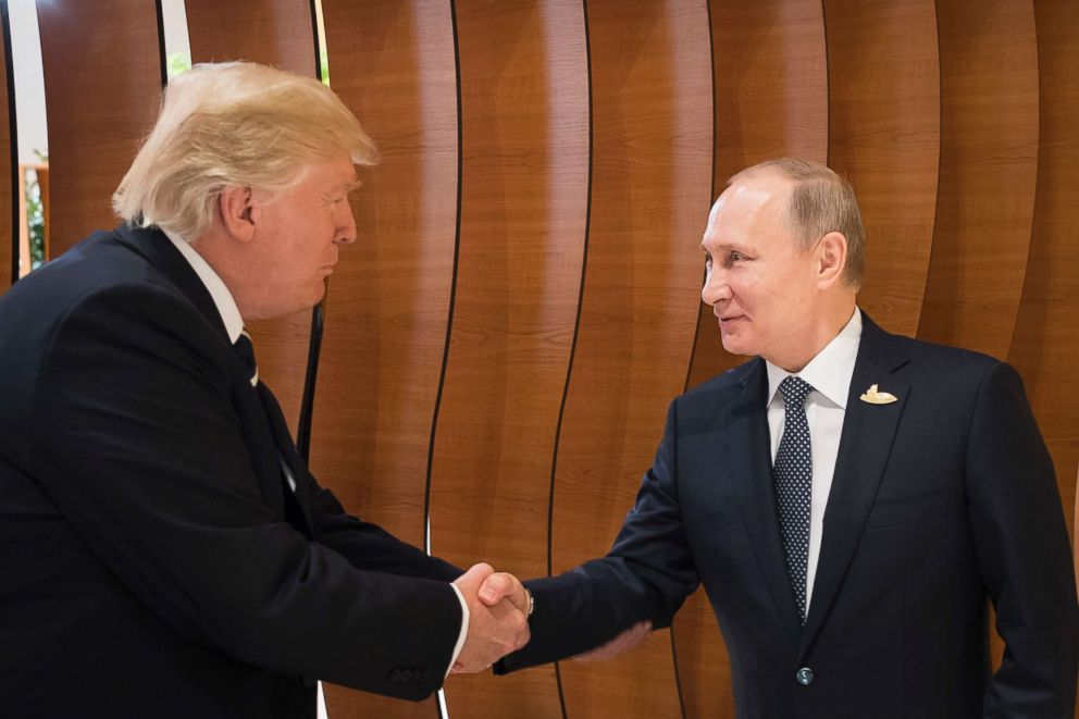 PHOTO: In this photo provided by German government President Donald Trump shakes hands with Russian President Vladimir Putin before the first working session of the G-20 summit in Hamburg, northern Germany, July 7, 2017.