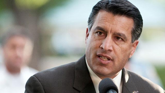 PHOTO: In this Sept. 25, 2011 photo Nevada Gov. Brian Sandoval speaks during a memorial service in Reno, Nev.