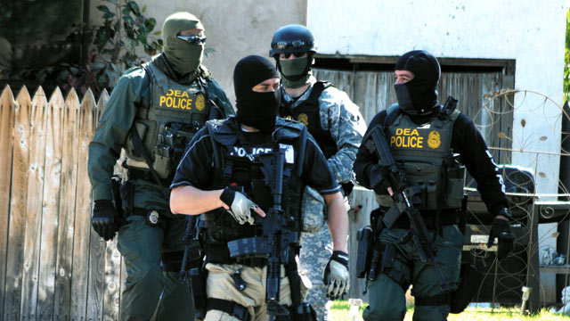 PHOTO: Drug Enforcement Administration Special Agents leave a house, Sept. 23, 2011, in Roswell, N.M., as part of an investigation that included the arrest of dozens of suspected drug traffickers.