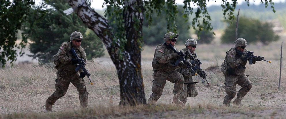 PHOTO: Members of the U.S. Army 173rd Airborne Brigade practice during the combined Lithuanian-U.S. training exercise at the Gaiziunai Training Area west of the capital Vilnius, Tuesday, July 7, 2015.