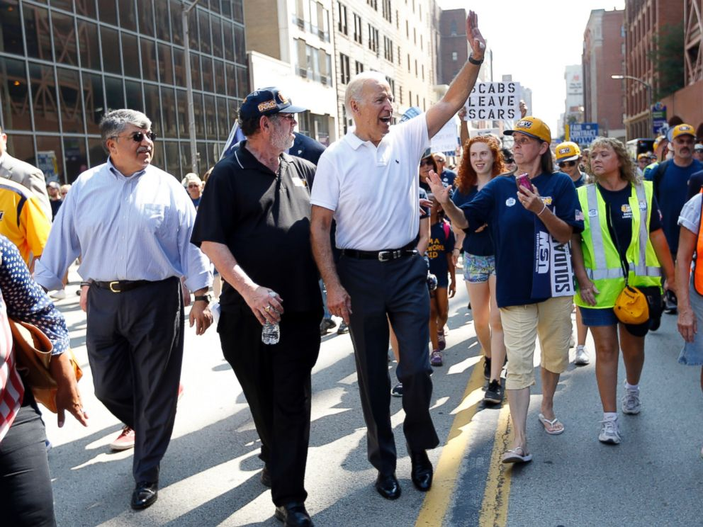 PHOTO: Vice President Joe Biden, center, walks with United Steelworkers President Leo Gerard, center left, and AFL-CIO President Rich Trumka, left, as he joins joins in the annual Labor Day parade on Sept. 7, 2015, in Pittsburgh.