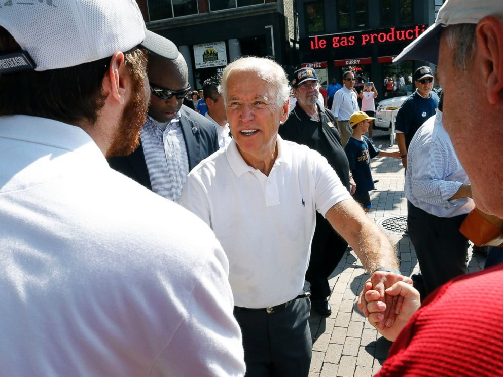 PHOTO: Vice President Joe Biden, center, greets some of the crowd as he walks in the annual Labor Day parade on Sept. 7, 2015, in Pittsburgh.