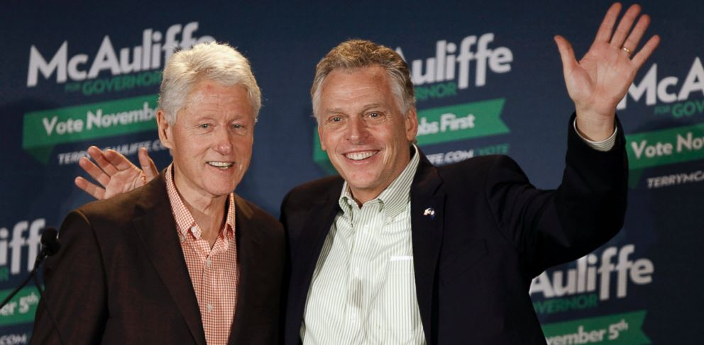 PHOTO: Former President Bill Clinton, left, and Democratic gubernatorial candidate Terry McAuliffe visit the Virginia Tech campus in Blacksburg Va., Oct. 28 2013.