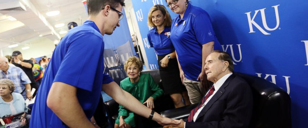 PHOTO: Cody Christensen, with the Dole Institute, shakes hands with Bob Dole at the KU booth in the Meadowlark Building at the Kansas State Fair, Sept. 7, 2014, in Hutchinson, Kan.