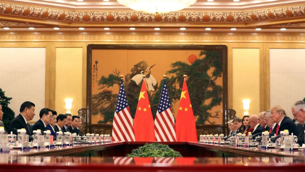 U.S. President Donald Trump, second right, and Chinese President Xi Jinping, left, attend a bilateral meeting at the Great Hall of the People in Beijing Thursday, Nov. 9, 2017.