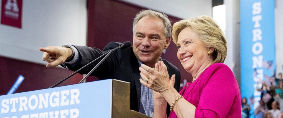 PHOTO: Democratic candidate Hillary Clinton and Democratic vice presidential candidate, Sen. Tim Kaine look to the audience as they finish speaking during a rally at Temple University in Philadelphia, July 29, 2016.