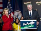 PHOTO: Former Secretary of State Hillary Clinton applauds Virginia gubernatorial candidate, Democrat Terry McAuliffe, during a campaign rally, Women for Terry, at the State Theater in Falls Church, Va. on Oct. 19, 2013.