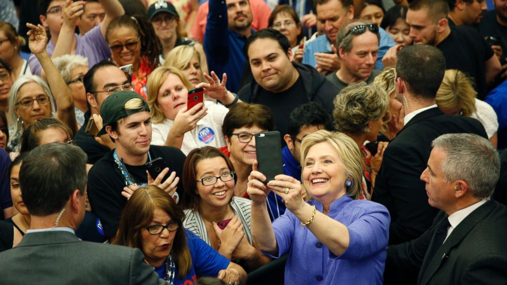 Hillary Clinton takes a selfie with supporters at a rally at California State University, San Bernardino, in San Bernardino, California, June 3, 2016.
