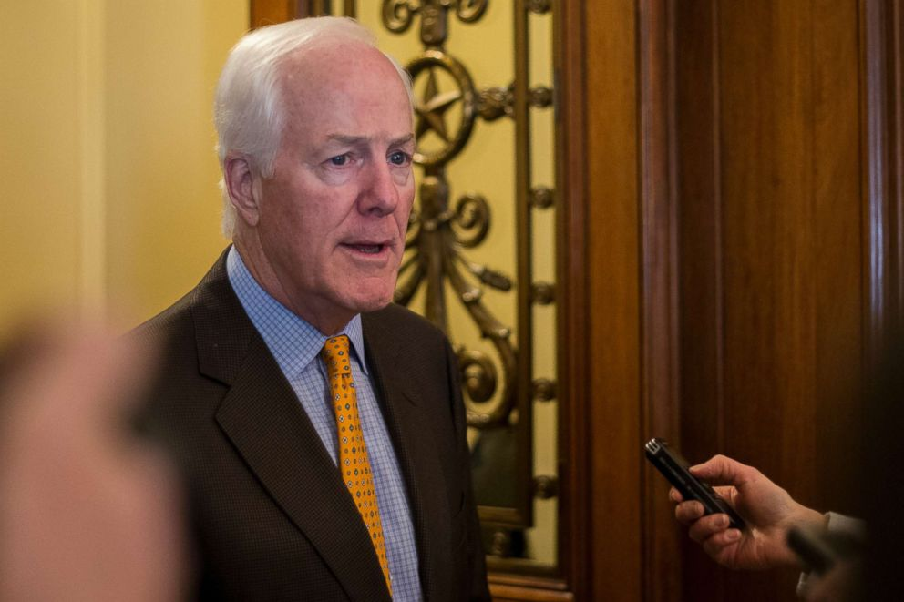 PHOTO: Senator John Cornyn talks with reporters outside the Senate Chamber in the United States Capitol Building in Washington, D.C., Jan. 19, 2018.