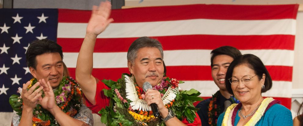 PHOTO: Hawaii Governor-elect David Ige, center, waves at the Democratic Coordinated Election Night Celebration at the Japanese Cultural Center of Hawaii in Honolulu, in this Nov. 4, 2014 file photo.