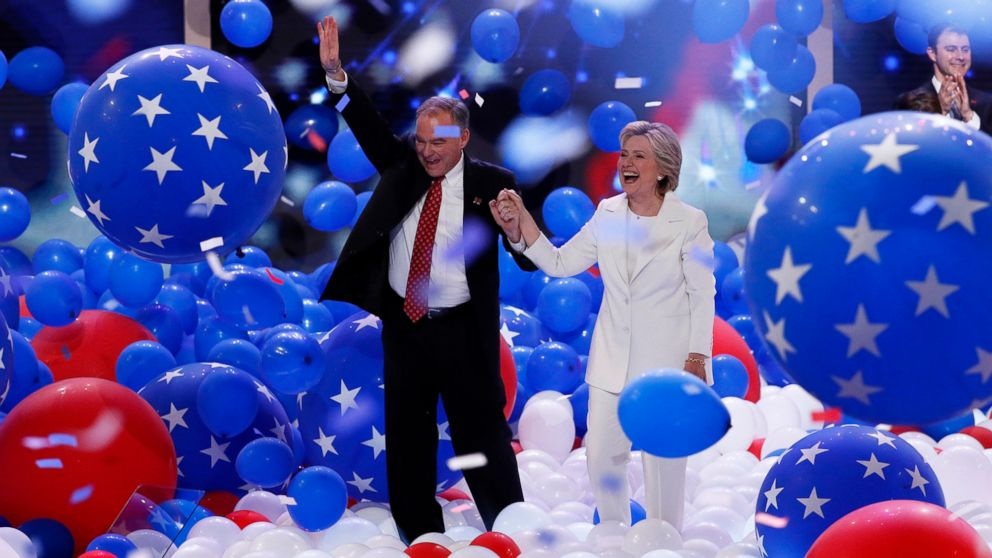 Democratic presidential nominee Hillary Clinton and Democratic vice presidential nominee Sen. Tim Kaine, walk through the falling balloons during the final day of the Democratic National Convention in Philadelphia, July 28, 2016.