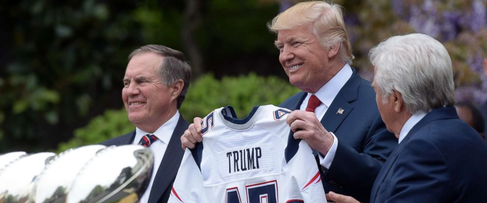 PHOTO: President Donald Trump is presented a New England patriots jersey by Patriots owner Robert Kraft, right, and head coach Bill Belichick during a ceremony at the White House in Washington, Wednesday, April 19, 2017.