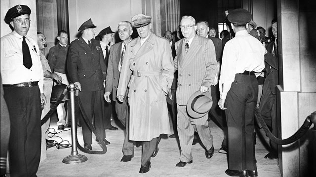 PHOTO: Gen. Douglas MacArthur is escorted through Senate office building in Washington, May 4, 1951. The general is on his way to his second day to testimony before a joint hearing of Senate Foreign Relations and Armed Services committees.