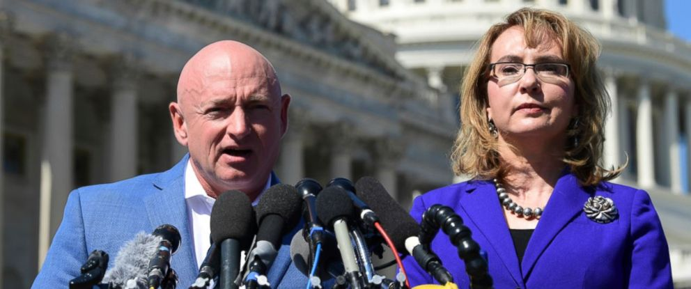 PHOTO: Former Rep. Gabrielle Giffords, D-Ariz., right, listens as her husband Mark Kelly, left, speaks on Capitol Hill in Washington, Monday, Oct. 2, 2017, about the mass shooting in Las Vegas.