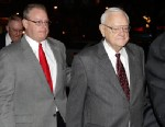 PHOTO: Former Illinois Gov. George Ryan, center, is accompanied with his son George H. Ryan Jr., left,  as he arrives at a halfway house in Chicago Jan. 30, 2013, after serving five-plus years in federal prison on corruption charges.