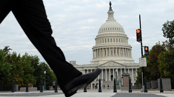PHOTO: People walk near Capitol Hill in Washington, Oct. 1, 2013 where Congress plunged the nation into a partial government shutdown.