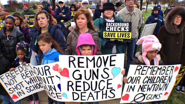 PHOTO: About 75 adults and children turned out for a gun control rally in Dr. Martin Luther King Jr. Park in Indianapolis, April 13, 2013.