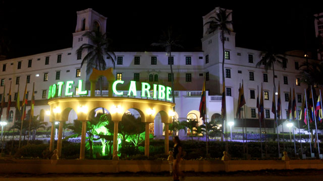 PHOTO: People walk past Hotel El Caribe in Cartagena, Colombia, April 19, 2012.