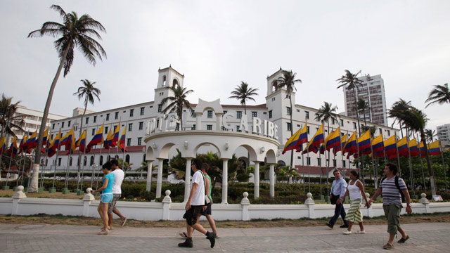 PHOTO: People walk past Hotel El Caribe in Cartagena, Colombia, Saturday April 14, 2012.