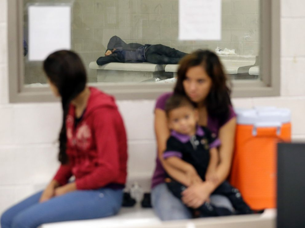 Detainees wait at a U.S. Customs and Border Protection processing facility, June 18, 2014, in Brownsville, Texas.