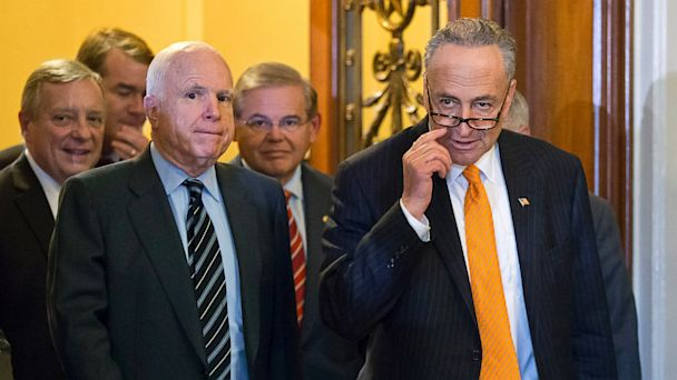 "PHOTO: Sen. Chuck Schumer, D-N.Y., right, and members of the Senates bipartisan ""Gang of Eight"" who crafted the immigration reform bill, leave the Senate floor after final passage, at the Capitol in Washington, June 27, 2013."