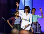 """PHOTO: First lady Michelle Obama, center, and daughters Sasha, left, and Malia, right, react during the """"Kids Inaugural: Our Children. Our Future."""" event in Washington, Saturday, Jan. 19, 2013."""