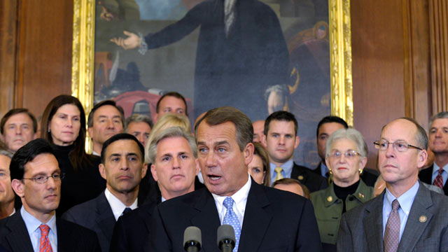 PHOTO: House Speaker John Boehner of Ohio, surrounded by Republican House members speaks during a news conference on Capitol Hill in Washington, Dec. 20, 2011.