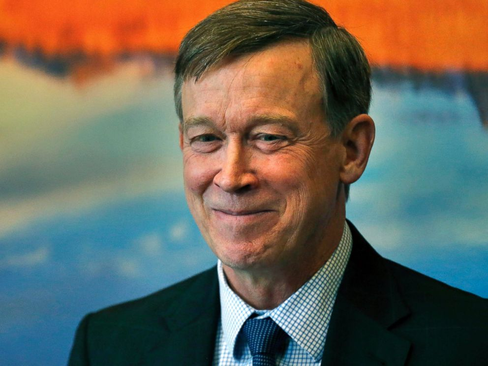 PHOTO: Colorado Gov. John Hickenlooper smiles while speaking to members of the media during a news conference inside his office at the state Capitol, in Denver, May 7, 2015.