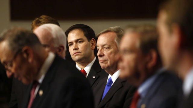 PHOTO: In this April 18, 2013 file photo, Sen. Marco Rubio, R-Fla., center, and others Senators, participate in a news conference on immigration on Capitol Hill in Washington.