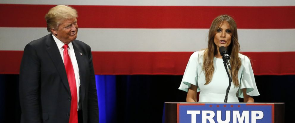 PHOTO: Republican presidential candidate, Donald Trump, left, listens to his wife Melania as she addresses the crowd during a rally at the Milwaukee Theatre Monday, April 4, 2016, in Milwaukee.