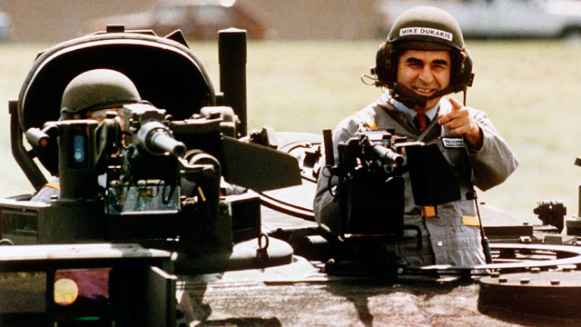 PHOTO: This Sept. 13, 1988 file photo shows Democratic Presidential candidate Michael Dukakis as he gets a free ride in one of General Dynamics' new M1-A-1 battle tanks at its land systems division in Sterling Heights, Mich.