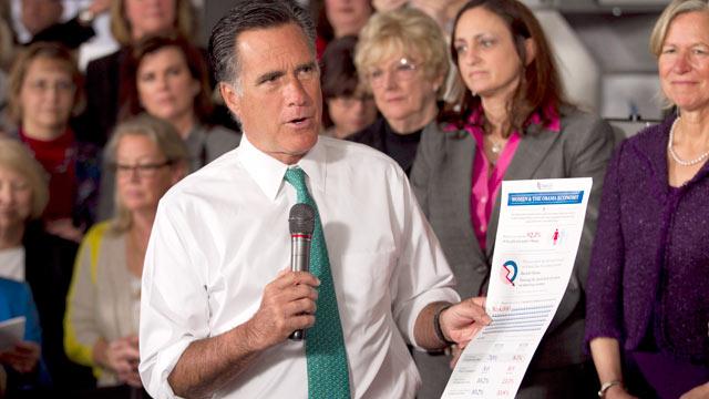 PHOTO: Mitt Romney, holds a flyer on as he speaks in Hartford, Conn., April 11, 2012.