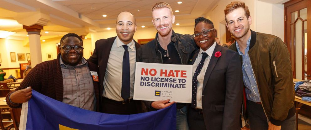PHOTO: Walking Dead actor Daniel Newman (center) poses for a photo with (l-r) Percy Brown, Malik Brown, Hope Jackson and Nick Morrow prior to a rally opposing legislation proposed by the Georgia legislature on Thursday, March 1, 2018, in Atlanta.