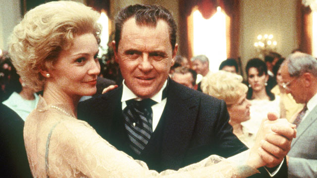 """PHOTO: Anthony Hopkins, playing the title role in Oliver Stone's """"Nixon,"""" dances with actress Joan Allen, who plays former first lady Pat Nixon, in a scene from the film."""