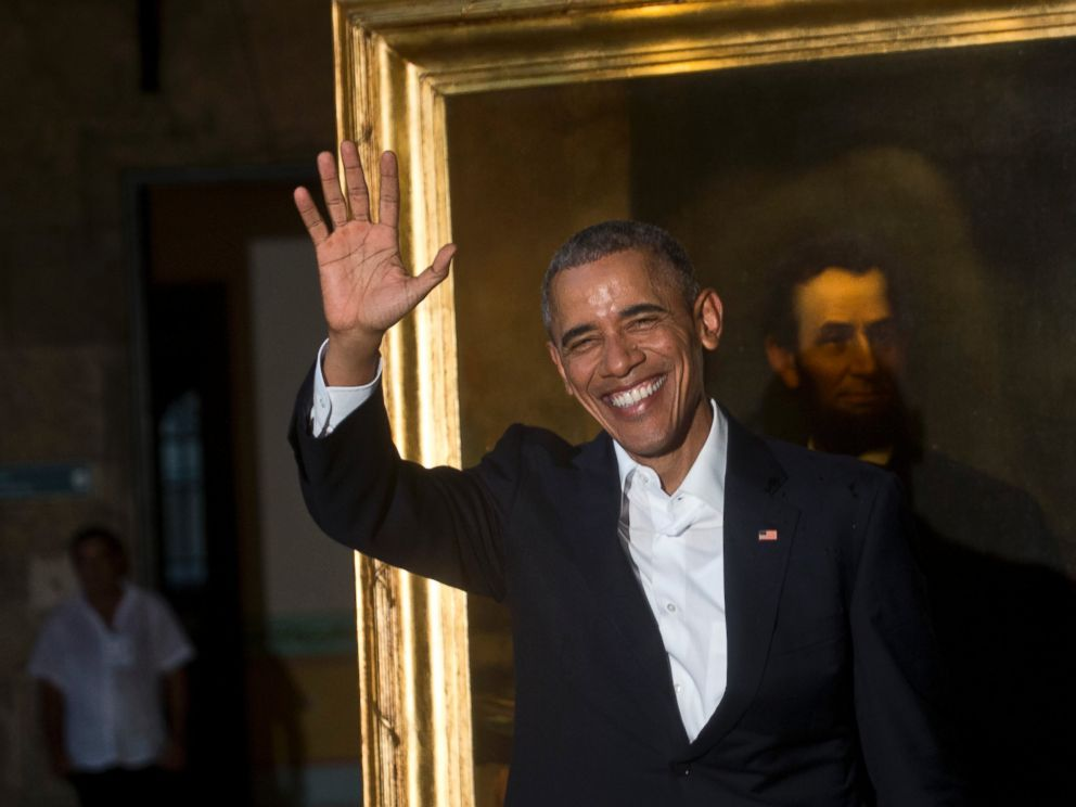 PHOTO: President Barack Obama waves to journalists next to a painting of President Abraham Lincoln at Havanas City Museum during a visit to Old Havana, Cuba, Sunday, March 20, 2016.