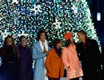 PHOTO: President Barack Obama, second from right, first lady Michelle Obama, center, Sasha Obama, Malia Obama and Michelle Obamas mother Marian Robinson, left of center, and others participate in the 90th annual National Christmas Tree Lighting ceremony