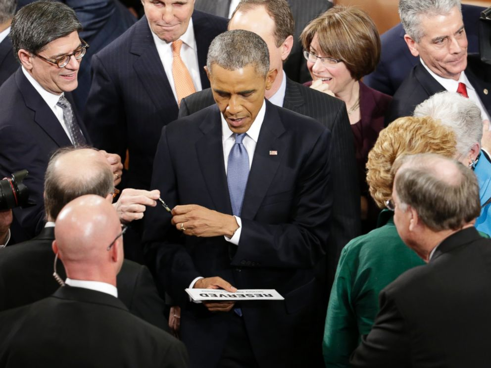 PHOTO: President Barack Obama prepares to sign an autograph on Capitol Hill in Washington, Jan. 20, 2015, after giving his State of the Union address before a joint session of Congress.