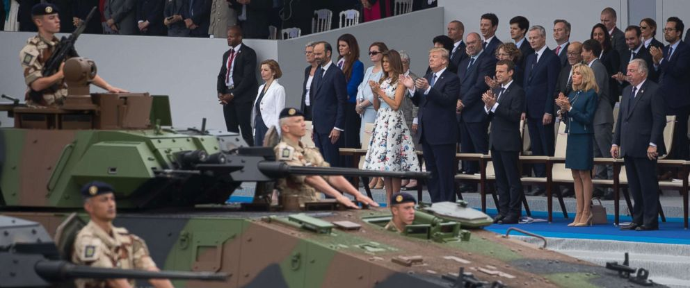 PHOTO: Tanks parade past President Donald Trump, first lady Melania Trump, French President Emmanuel Macron and his wife Brigitte Macron, during Bastille Day parade on the Champs Elysees avenue in Paris, Friday, July 14, 2017.